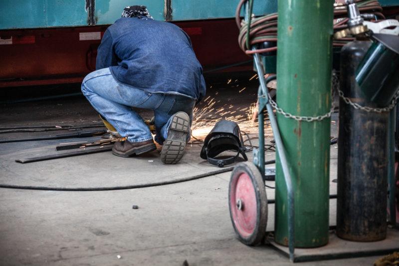 A man installing an emergency boiler rental in Columbus, GA